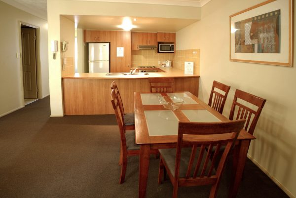 6 guest settings in our 2 bedroom apartments with full  kitchens